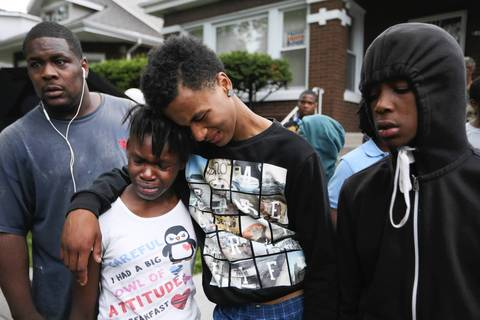 Deja Bates, 11, second from left, is comforted by Marca Parker, who was a friend of her brother, on July 5, 2014. Bates' brother was allegedly shot and killed by a member of the Chicago Police Department at the 8700 block of South Morgan Street.