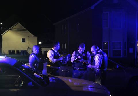 Police investigate the scene where a 24-year-old man was shot to death at about 2:20 a.m. at 84th Street and Buffalo Avenue in The Bush neighborhood on July 7, 2014.