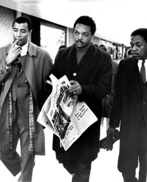 As he walked through O'Hare Airport on April 5, 1968, civil rights leader and minister Jesse Jackson held a copy of the Chicago Daily Defender newspaper which featured the headline 'King Murdered!' The headline referred to the assassination of Dr. Martin Luther King Jr. the day before, on the evening of April 4, with Jackson at his side.