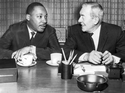 Martin Luther King Jr., left, has a coffee break with Chicago Police Superintendent O.W. Wilson in Wilson's office at 11th and State streets in Chicago on Jan. 27, 1966.