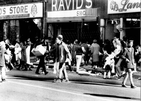 Widespread looting devastated blocks of West Side shops during the riots following the assassination of Martin Luther King Jr. in 1968. Three hundred-fifty people were arrested for looting, and 162 buildings were destroyed by arson.