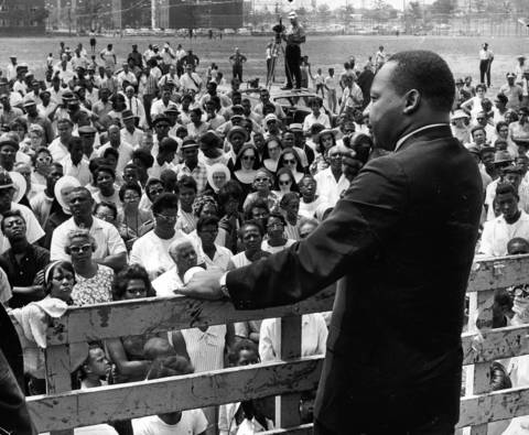 Civil rights leader Rev. Martin Luther King Jr. addresses a crowd at 48th and State streets during his three-day lecture and marching visit to Chicago.