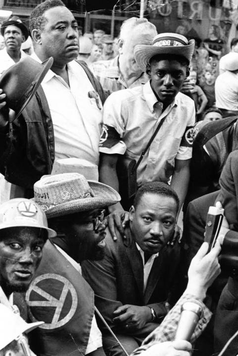 "Martin Luther King Jr. and supporters stop at a realtor's office during their march through Chicago's Marquette Park, where he and supporters were protesting housing segregation and slums in Chicago. On the neighborhood's negative reaction to the march, King later said, ""I've never seen anything like it."""