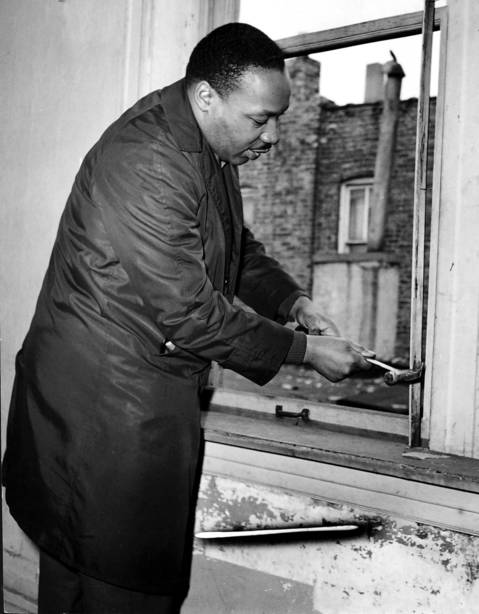 Martin Luther King Jr. helps remove a window frame while renovating an apartment at 1321 S. Loman Ave. in Chicago in 1966. King moved into a West Side apartment at 1550 S. Hamlin Ave. to highlight housing segregation issues in Chicago.