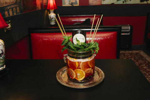 """Grande Royale (Housemade creme de cassis, Campari and allspice dram; cognac; Calvados apple brandy; and Peychaud's and housemade wild lemon bitters topped with a bottle of champagne, $280): Like a beergarita in a crunk cup the size of a cookie jar, this slushy colossus for 8-10 is topped with an inverted bottle of champagne and tastes like you might expect—a little sweet, a little bitter and a lot like rich people. Is there a better way to say, """"I'm expensive, AND I know how to party""""?"""