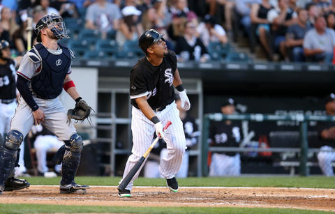 Jose Abreu drives in a run with a sacrifice fly in the second inning against the Braves at U.S. Cellular Field on July 8, 2016.