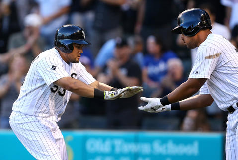 Melky Cabrera (left) is congratulated by Jose Abreu after Cabrera hit a two-run homer in the third inning against the Royals at U.S. Cellular Field in Chicago on June 10, 2016.