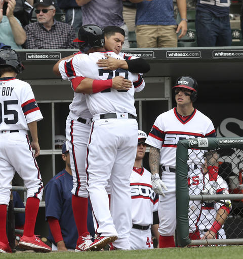 Jose Abreu gets a hug from Avisail Garcia after his home run against the Royals during the sixth inning on June 12, 2016, at U.S. Cellular Field.