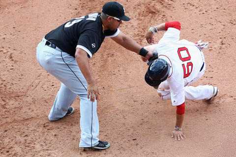 Jose Abreu tags out the Red Sox's Mookie Betts at first during the sixth inning at Fenway Park on June 23, 2016.