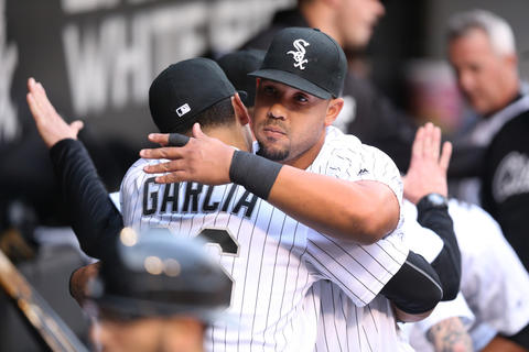 Jose Abreu and Avisail Garcia hug in the dugout before taking on the Red Sox at U.S. Cellular Field on May 3, 2016.