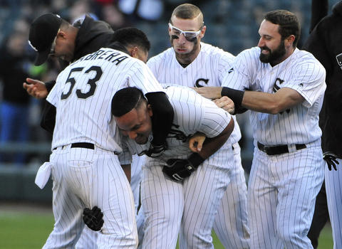 Jose Abreu celebrates his game-winning single against the Rangers with his teammates after a 4-3 win in 11 innings on April 23, 2016.