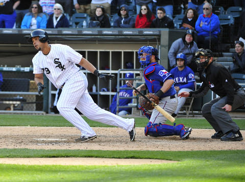 Jose Abreu hits the game-winning single against the Rangers during the eleventh inning on April 23, 2016.