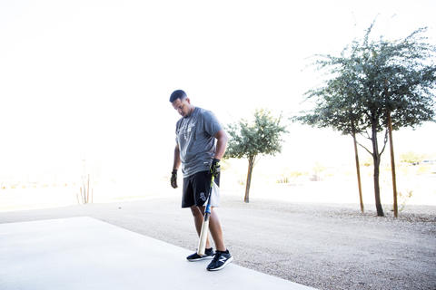 Jose Abreu takes a break while batting before the first full squad workout onTuesday, Feb. 23, 2016, in Glendale, Ariz.