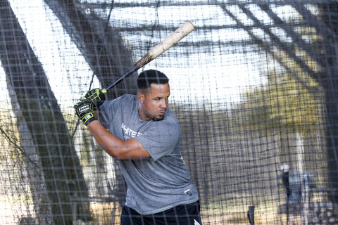 Jose Abreu bats before the first full squad workout onTuesday, Feb. 23, 2016, in Glendale, Ariz.