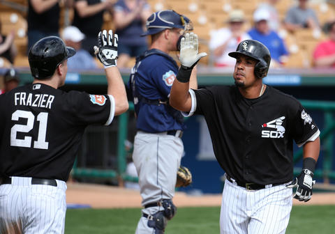 Jose Abreu high-fivesTodd Frazier after Abreu hit a home run against the Padres at Camelback Ranch in Glendale, Ariz.,on Sunday, March 6, 2016.