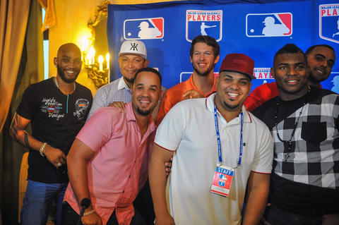 Alexei Ramirez, Miguel Cabrera, Jose Abreu, Clayton Kershaw, Brian Pena, Yasiel Puig and Nelson Cruz pose for a picture at the National Hotel in Havana, on December 15, 2015. Cuban baseball stars Abreu and Puig are returning home for the first time since defecting to join the big leagues, part of an unprecedented MLB tour made possible by the thaw in US-Cuban relations.