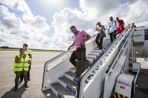 Jose Abreu walks off the plane after arriving in Havana, Cuba onDecember 15, 2015.