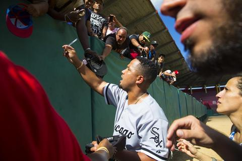 Jose Abreu signs autographs for fans after giving a baseball clinic to young players in Matanzas, Cuba, on Dec. 17, 2015. A lineup of Cuban baseball superstars including some of the most famous defectors in recent memory made a triumphant return to Cuba as part of the first Major League Baseball trip to the island since 1999.