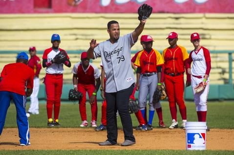 Jose Abreu conducts a clinic for young players in Matanzas, Cuba, on Dec. 17, 2015. A lineup of Cuban baseball superstars including some of the most famous defectors in recent memory made a triumphant return to Cuba as part of the first Major League Baseball trip to the island since 1999.