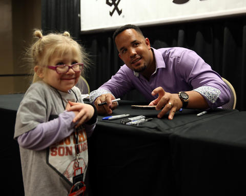 5-year-old Lily Shure is all smiles as she meets Jose Abreu at SoxFest 2016.