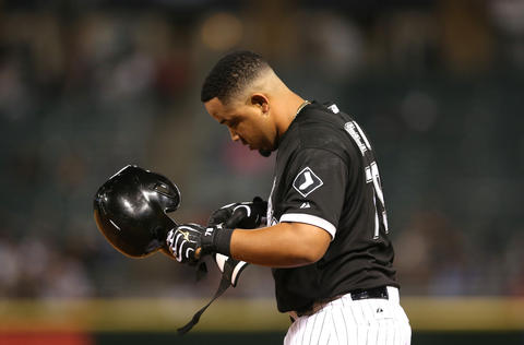 Jose Abreu takes off his helmet after grounding into a double play to end the fifth inning against the Red Sox.