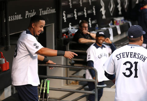 se Abreu has a laugh with hitting coach Todd Steverson before a game against the Mariner. The Sox wore uniforms in the style of the 1976 team for Throwback Thursday.