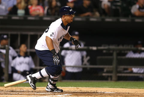 Jose Abreu drives in a run with a double in the third inning of a game against the Mariners. The Sox wore uniforms in the style of the 1976 team for Throwback Thursday.