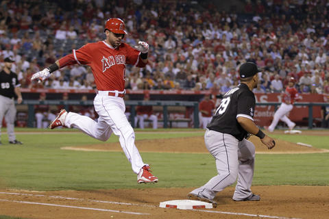Jose Abreu fields the throw for the out on the Angels' Kaleb Cowart during the seventh inning.