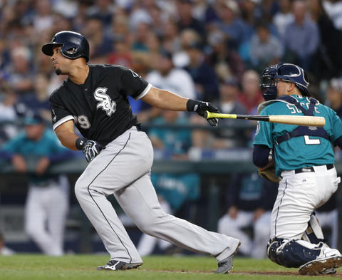 Jose Abreu watches an RBI double against the Mariners.