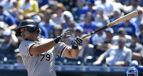 Jose Abreu follows through on an RBI single to score Adam Eaton during the first inning against the Royals.