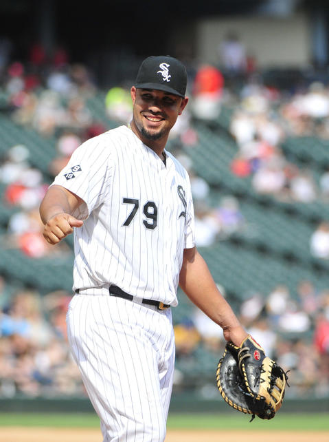 Jose Abreu waves to a fan during the ninth inning of a baseball game against the Indians.