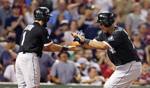 Jose Abreu, right, is congratulated by teammate Adam Eaton after his two-run home run off Red Sox starting pitcher Wade Miley.