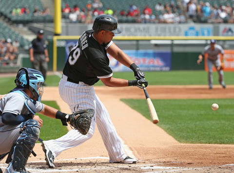 Jose Abreu hits a run-scoring single in the firstinning against the Rays at U.S. Cellular Field.
