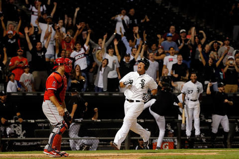 Jose Abreu celebrates as he scores the game-winning run off of a one run RBI double by Avisail Garcia. The White Sox won 3-2 in 13 innings against the Angels.