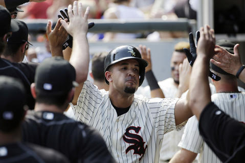 Jose Abreu celebrates with teammates after scoring on a double by Avisail Garcia during the first inning against the Cubs.
