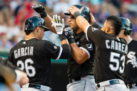 Avisail Garcia and Melky Cabrera celebrate with Jose Abreu after Abreu hit a solo home run during the sixth inning against the Indians.