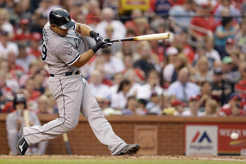 Jose Abreu hits an RBI single during the third inning against the Cardinals.
