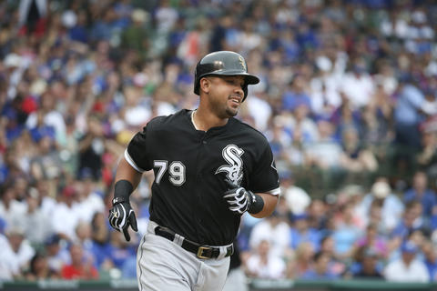 Jose Abreu hits an RBI single during the first inning against the Cubs at Wrigley Field.