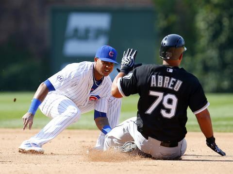 Cubs shortstop Starlin Castro tags out Jose Abreu during a double play in the sixth inning.