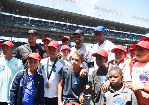 Jose Abreu, Alexei Ramirez and the Cubs' Jorge Soler pose for a photo with a Cuban youth baseball team, The Habaneros, at Wrigley Field.