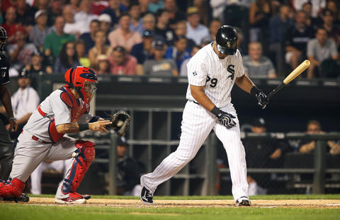 Jose Abreu swings at a dropped third strike to end the fifth inning against the Cardinals at U.S. Cellular Field.