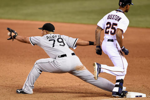 The Twins' Byron Buxton reaches first base on an infield single as Jose Abreu fields the ball during the sixth inning.