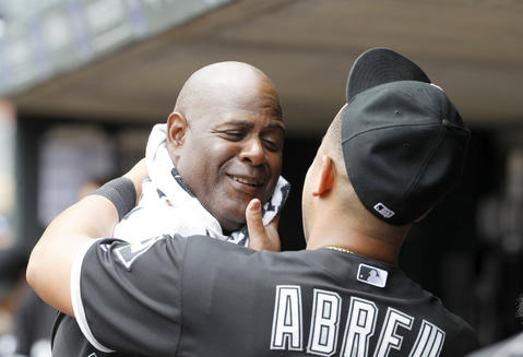 Jose Abreu, right, wipes off first base coach Daryl Boston, left, before a game against the Twins.
