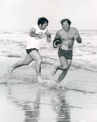 Johnny Bench, left, and Ron Santo play football on the beach on Padre Island, Texas, in 1973.
