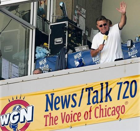 """Ron Santo sings a round of """"Take me out to the ball game"""" in the 7th inning stretch of the Cubs vs Phillies game at Wrigley Field."""