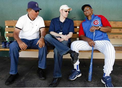 Ron Santo, Len Kasper and Billy Williams shares stories in the dugout at Chicago Cubs spring training in Mesa, Arizona.