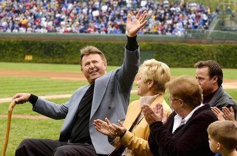 Ron Santo acknowledges cheering fans during the ceremony at Wrigley Field when the Cubs retired his number before the team's final regular-season game.