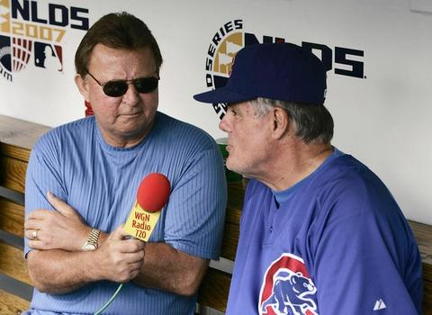 Cubs radio announcer Ron Santo interviews Manager Lou Piniella before game number three of the National League Division Series between the Chicago Cubs and the Arizona Diamondbacks at Wrigley Field.