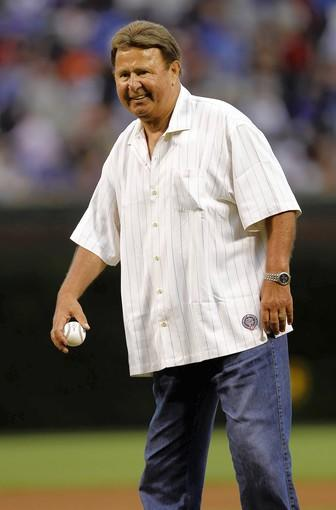 Legendary Chicago Cubs player and broadcaster Ron Santo throws out the ceremonial first pitch before the Chicago Cubs play Pittsburgh Pirates at Wrigley Field in Chicago in June 2010.