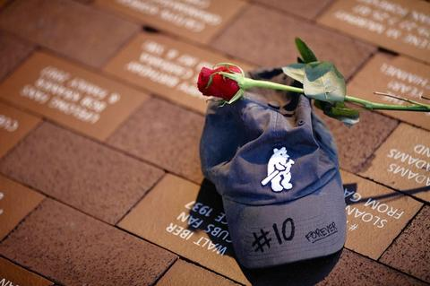 """A memorial rests in front of Wrigley Field for legendary Chicago Cubs player and broadcaster Ron Santo on Friday. Santo lapsed into a coma on Wednesday and died of complications from bladder cancer Thursday night in Arizona. """"The Cubs have lost their biggest fan,"""" said Santo's broadcast partner Pat Hughes."""